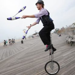 unicycle and man ready and waiting for your next event