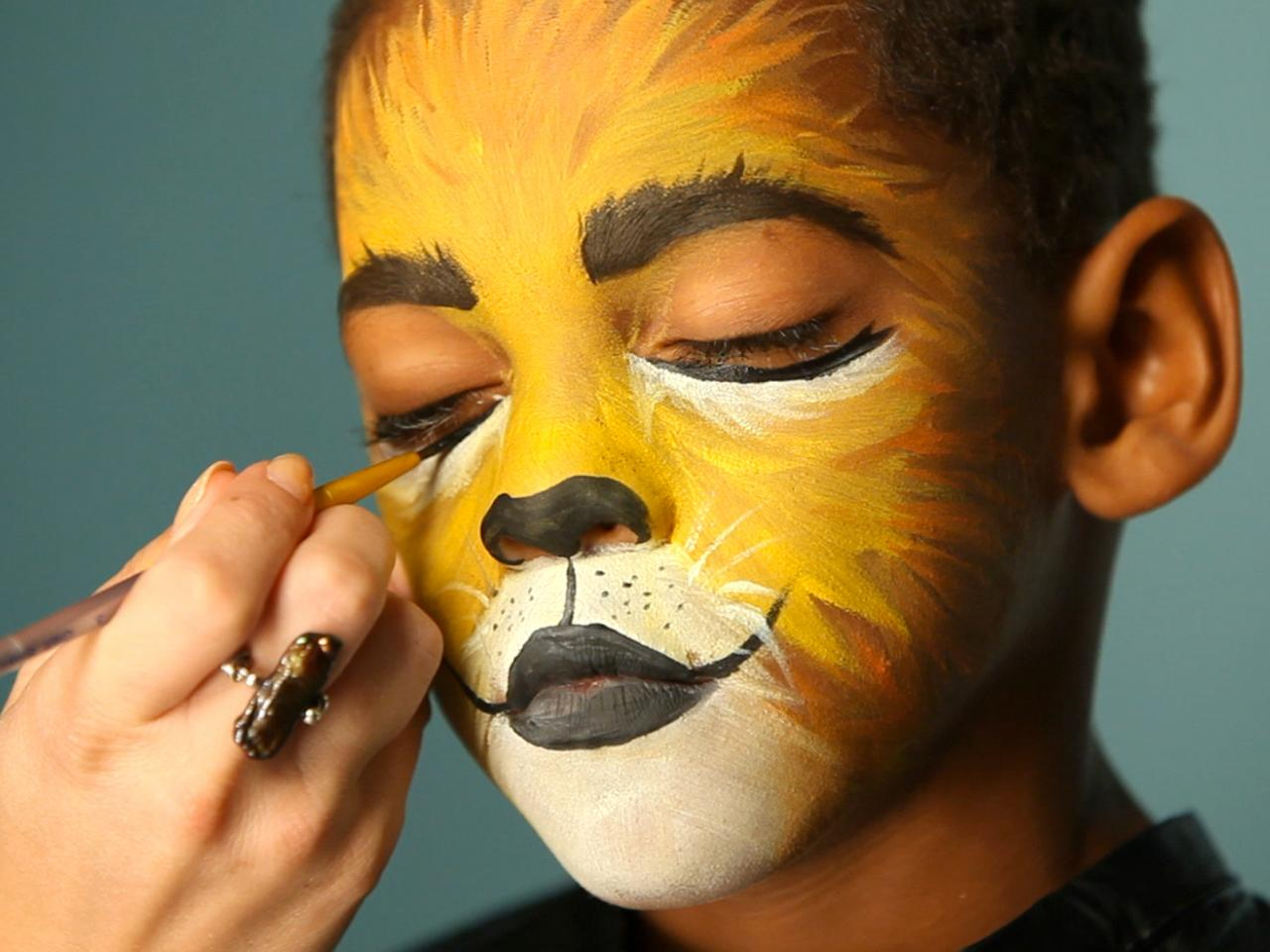 facepainting young mixed race boy
